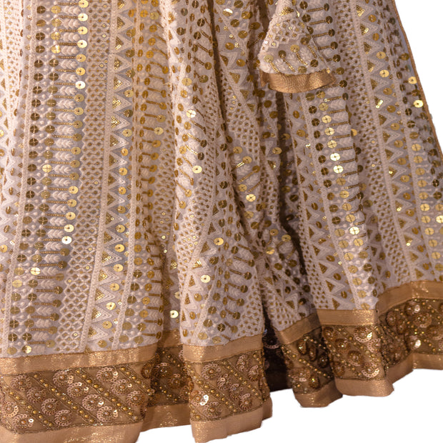 White lehenga with sequins embroidery on skirt and top.