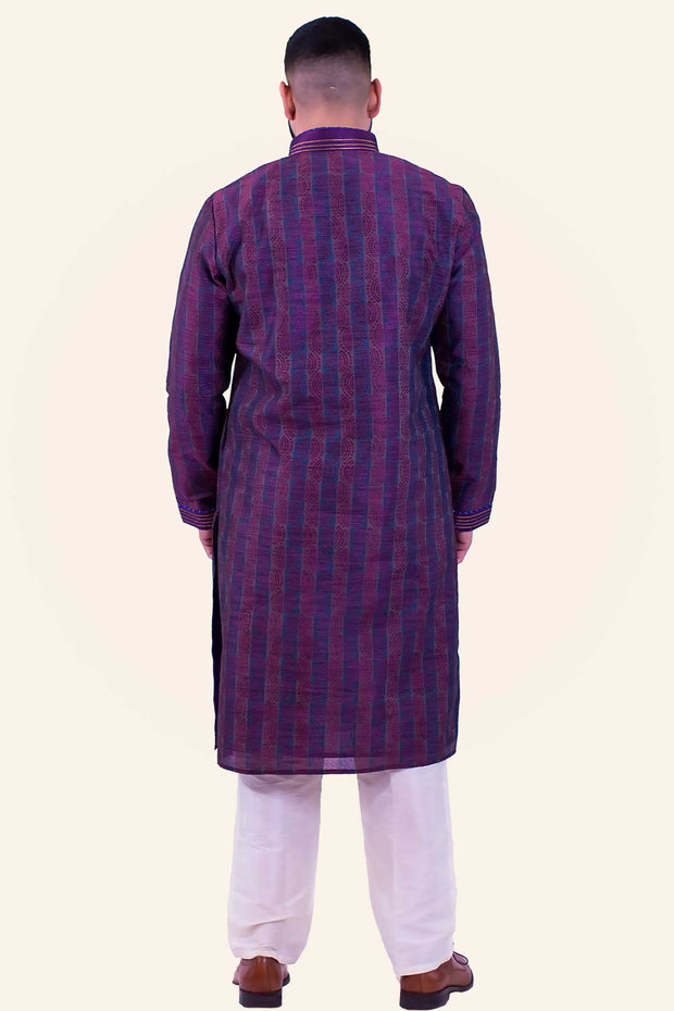 Masculine deep purple light weight kurta with copper detail on collar and suddle elegant print throughout the kurta. Paired with white bottoms.
