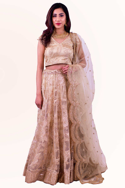 Fully embellished gold hand sewn embroidery from head to toe. Ranges from mellow to intense hues of gold in blouse and skirt.