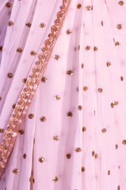 White chiffon sari covered in gold sequin polka dots and a beautiful thin gold border.