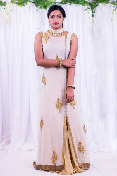 Gorgeous white kurta with detailed gold work on neckline and shoulders paired with a gold skirt to creating a layering effect.