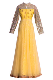 Pastel yellow gown/ anarkali with high neck and full sleeves with maroon thread work on top and embroidered sleeves. Yellow net bottom with layover and gold border.