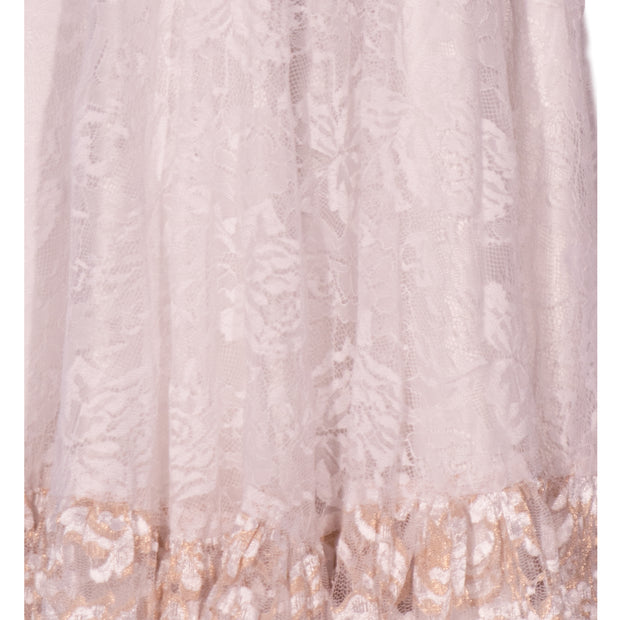 White lace dress, knee length for a modest appeal, subtle beige border.