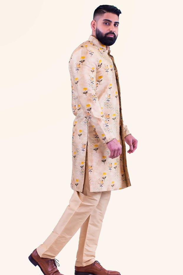 Amber colored and floral printed Kurta set. Rich golden sherwani with floral print. Paired with matching gold pants.