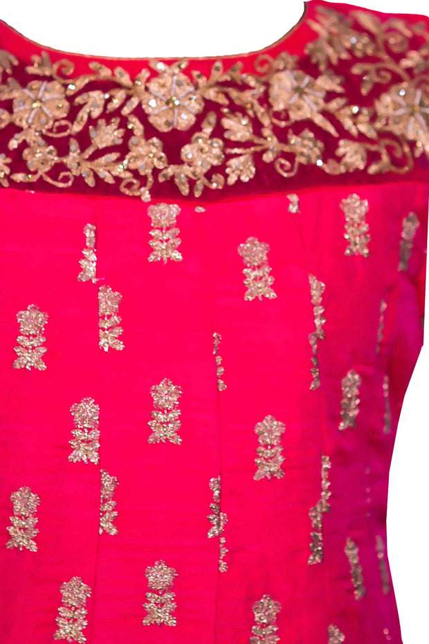 Cherry pink gown/ anarkali with hand crafted gold work on neckline and small intricate flowers through out the gown.