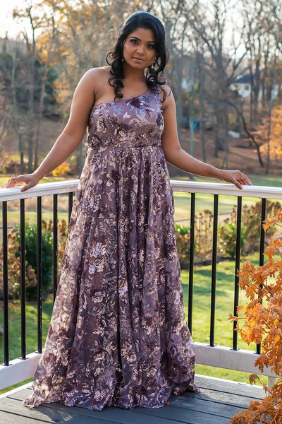 Elegant mauve net gown with exuberant flower pattern. Shine perfectly as any event.