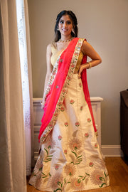 Ravishing teal green speckled sari, with traditional hand crafted embroidery on pallu. Border covered in pink and gold design.  Specially detailed embroidery using gold thread.