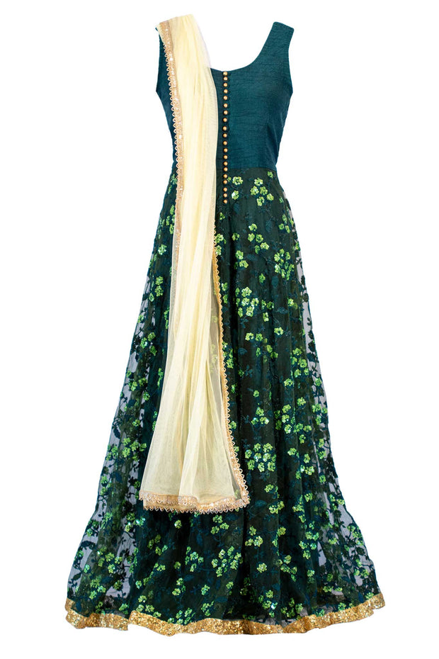 Hunter green gown with beautiful layover which features green sequins flowers. Paired with a very light yellow dupatta.