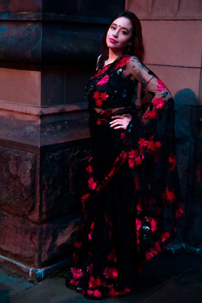 Vampy black net sari covered in red roses, embroidered through out the saree.