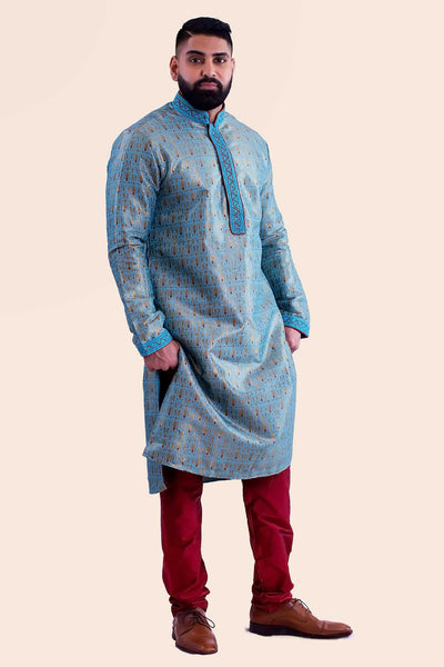 Vibrant blue Kurta with embroidered collar, and red thread work. Paired with deep red mahogany draw string bottoms.