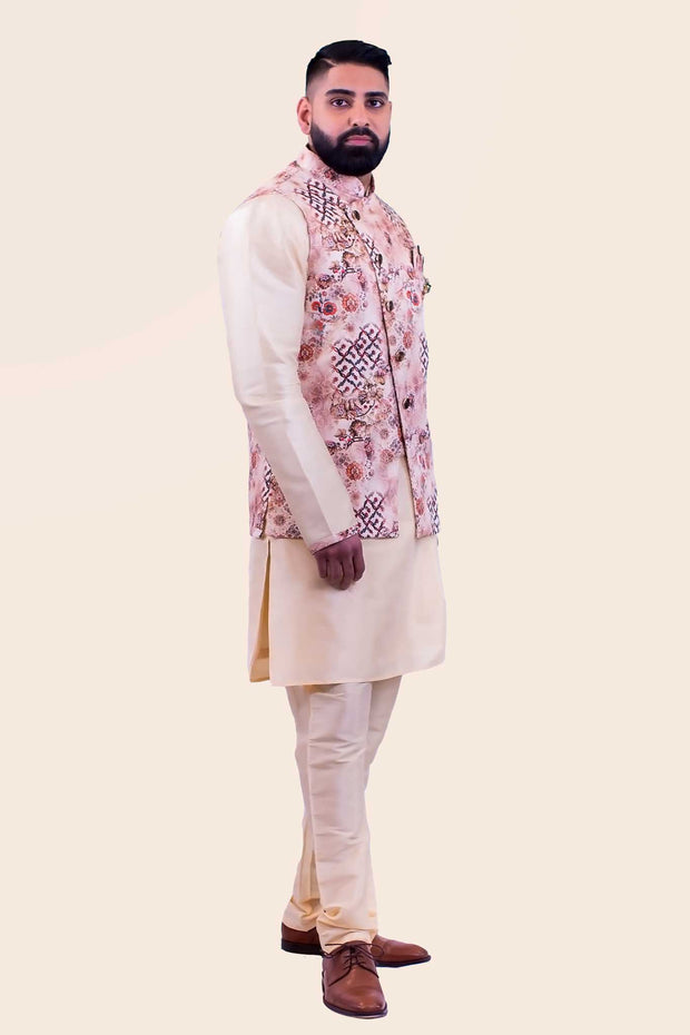 Three piece champagne colored kurta paired with cherry blossom print sherwani, paired with matching champagne colored pants.