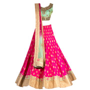 Bridal Pink Lengha with classic motif embroidery and contrast colored green blouse.