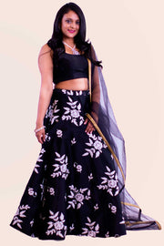 Deep black two piece lehenga with white flower thread embroidery skirt. Paired with black blouse. Finish this look by draping matching net dupatta on shoulders/ shoulder.