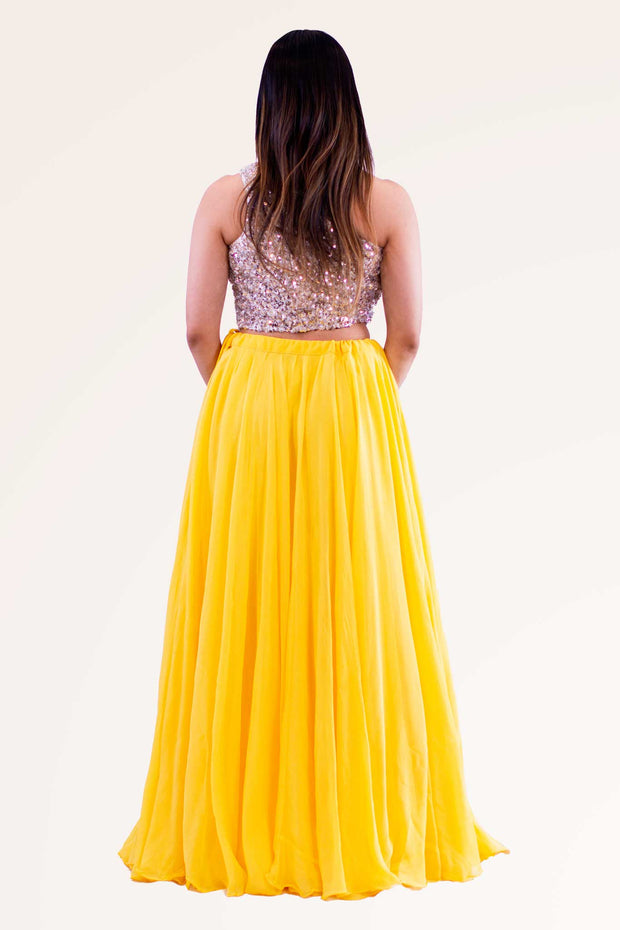 Radiant yellow skirt with slight pleating in the center. Silver glittery one shoulder blouse.