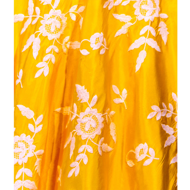 Yellow lehenga with white thread flower workCoy two piece yellow lehenga with luscious white flowers threaded on skirt. Paired with simple modern blouse. Finish this look with yellow chiffon dupatta decorated with gold trim on shoulders/ shoulder.