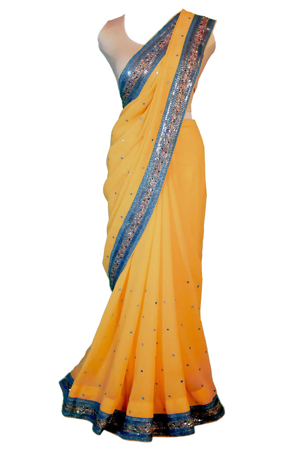 Yellow chiffon sari, sequence through out the yellow with a beautiful border in blue with more detail sequence, a perfect combination of elegance and chic.