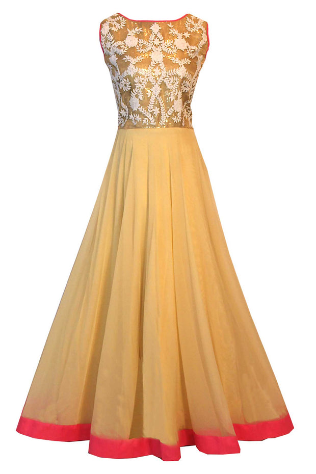 Coy gown designed with gold top, embroidered with white blossomed flowers and leaves. Soft yellow bottom fabric with a contrast border. Call this the perfect neutral shade!