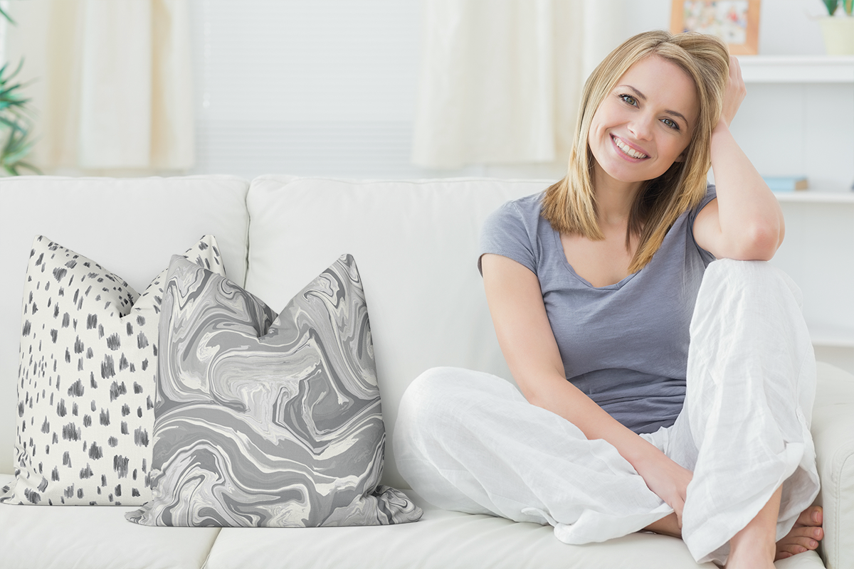 Woman on Sofa with Color of the Year pillows