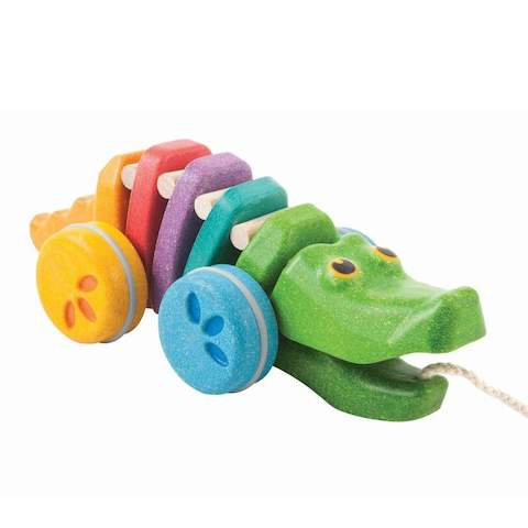 Rainbow coloured dancing pull along dancing Alligator toy by Plan Toys