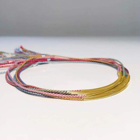 Silk Bracelets by Yab Studio. With eye-catching colours, these Gold Plated Silk Bracelets will make a standout addition to any jewellery collection.