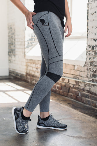 Gray athletic leggings with matching gray shoes