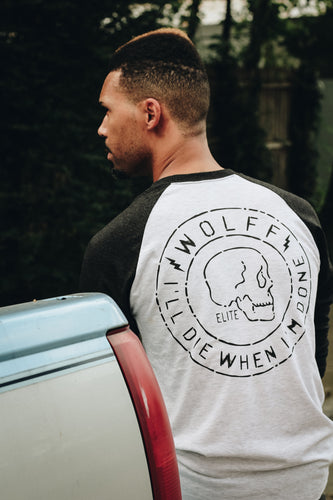back side of black and white baseball tee with skull graphic design