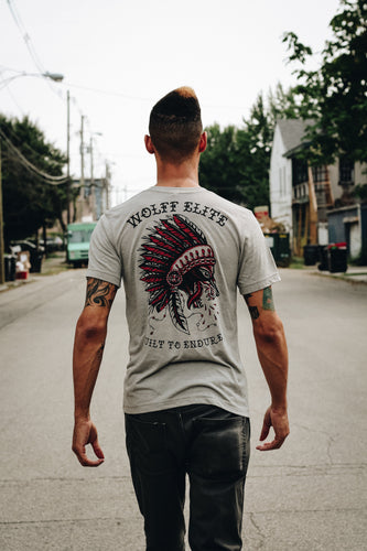man walking down street in athletic shirt