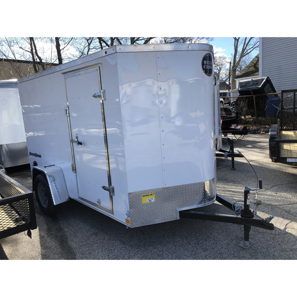 Wells Cargo 6 x 10 Enclosed Trailer with ramp door. White enclosed 6 x 10 Wells Cargo Trailer