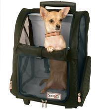 Dog in rolling pet carrier with wheels.