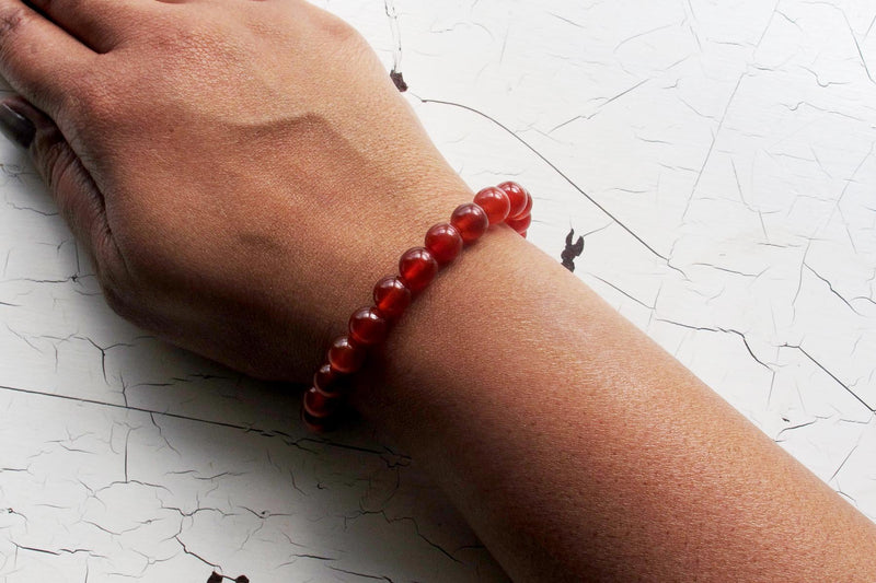 Carnelian energy bracelet models arm