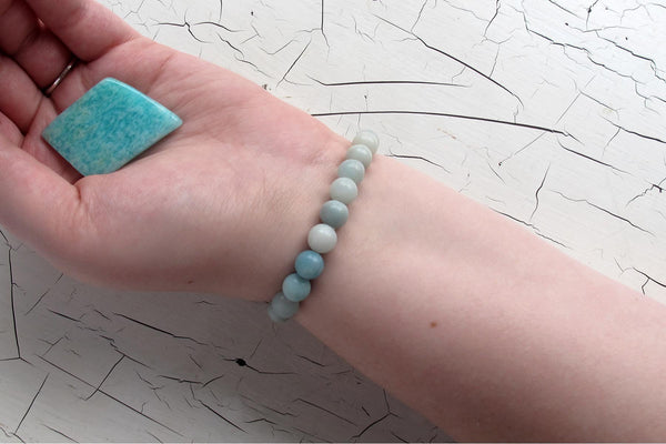 Amazonite energy bracelet models arm with crystal