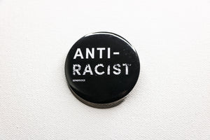 Black button with 'Anti-Racist' and 'Be the Bridge' in white lettering.