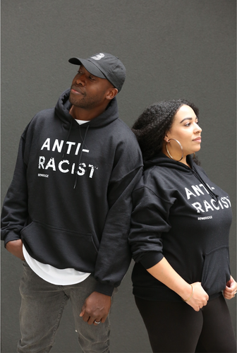 Man and Woman wearing black hoodies with 'Anti-Racist' in white lettering.