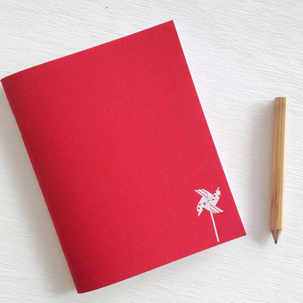 red pinwheel pocket journals