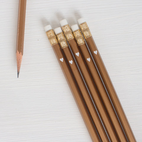 gold pencils with white heart