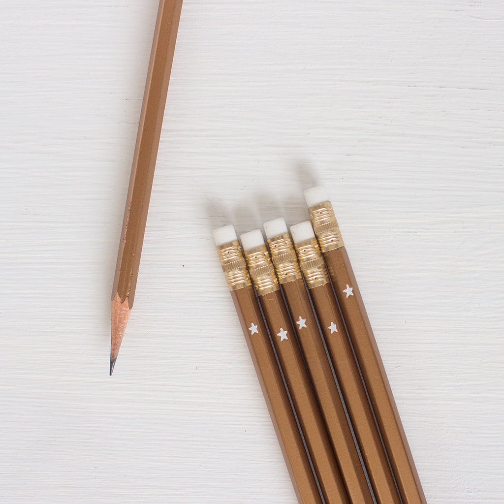 gold pencils with white star