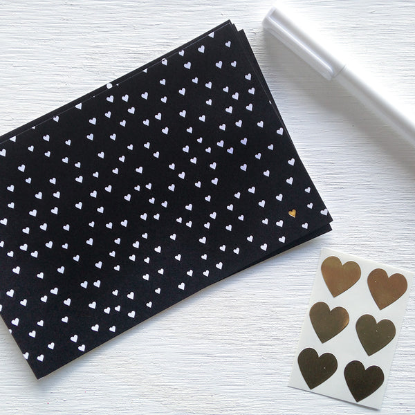 black, white and gold heart confetti postcards
