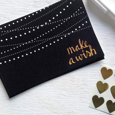 black, white and gold make a wish postcards