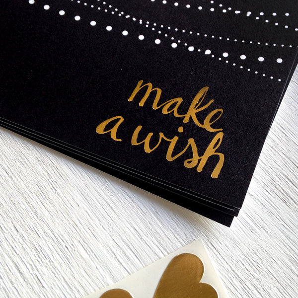 black, white and gold assorted postcards