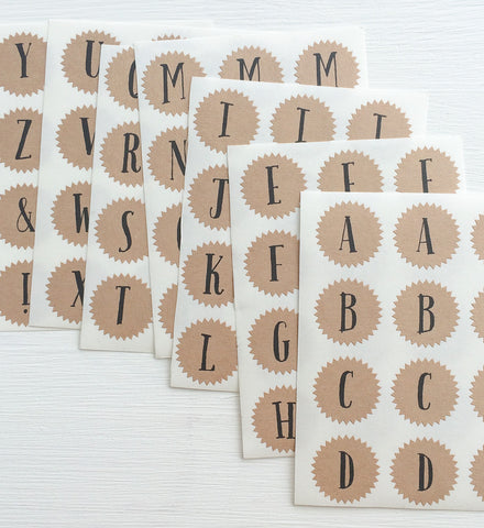 tiny kraft starburst stickers - alphabet