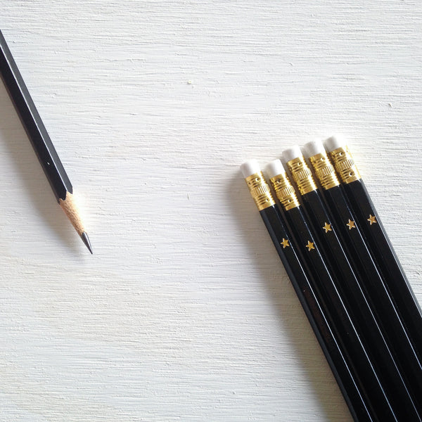 black pencils with gold foil star