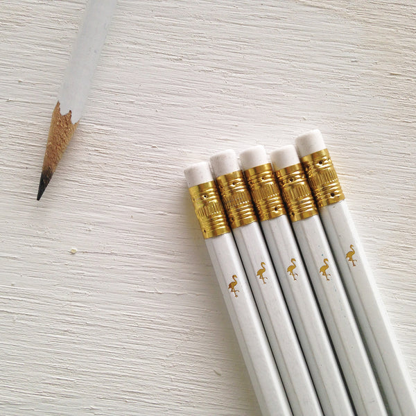 white pencils with gold flamingo