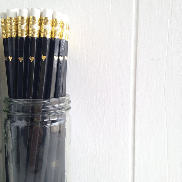 black pencils with gold foil heart