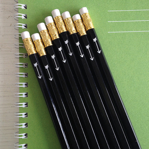 black pencils with white foil arrow