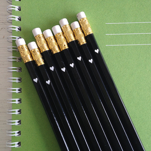 black pencils with white foil heart