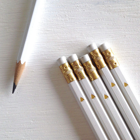white pencils with gold christmas tree