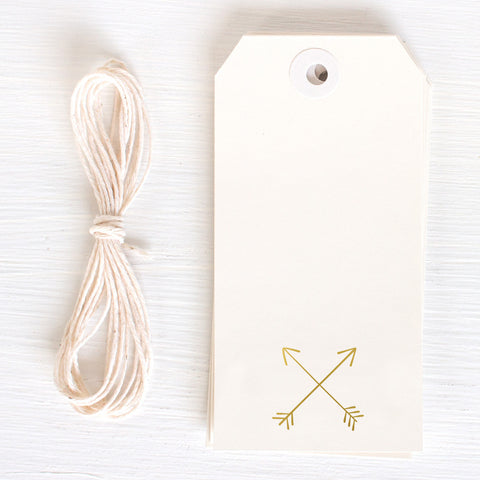 gold gift tags - crossed arrows