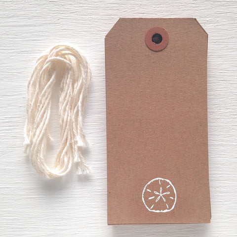 kraft gift tag with white foil sand dollar