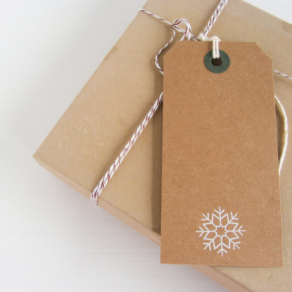 kraft gift tag with white foil snowflake