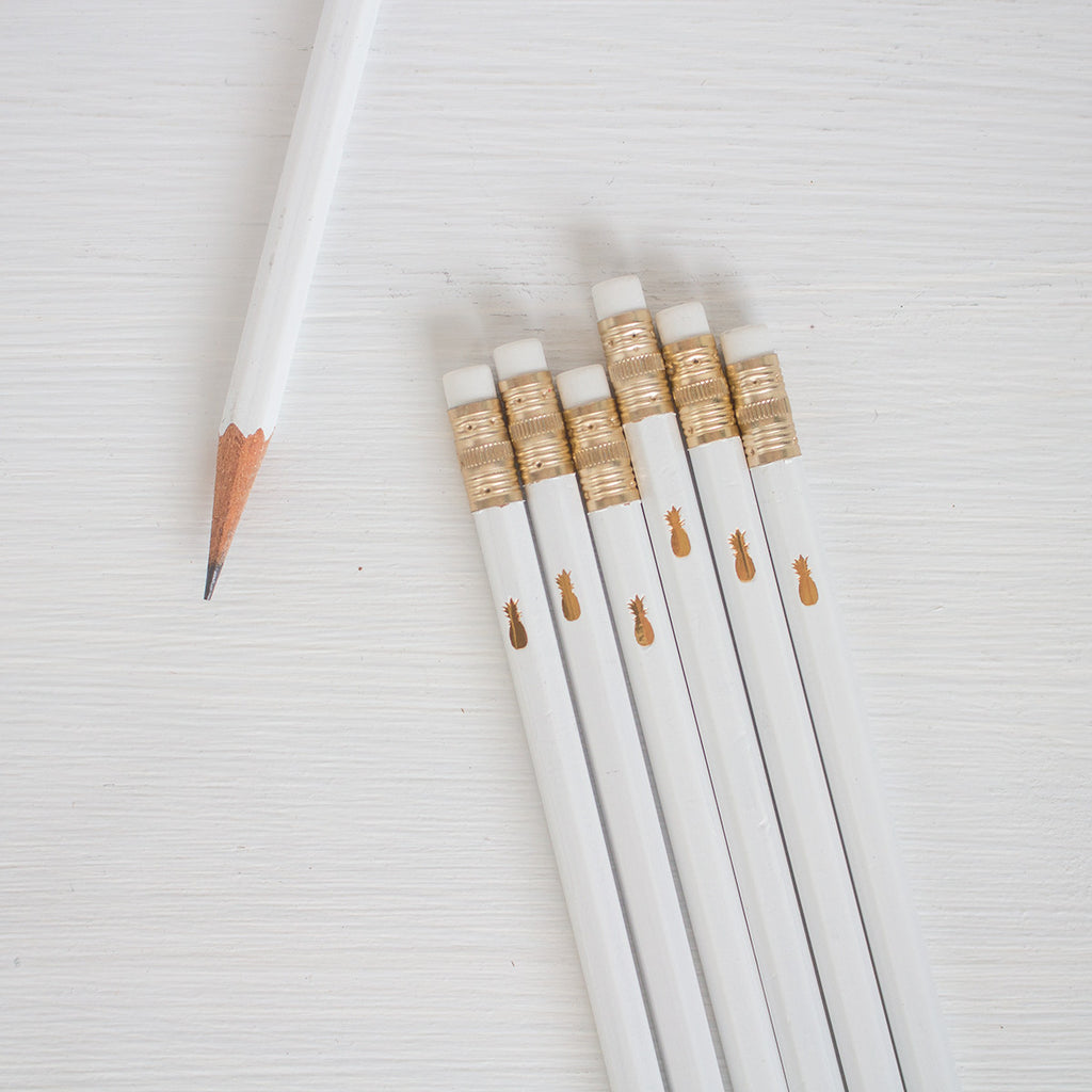 white pencils with gold pineapple
